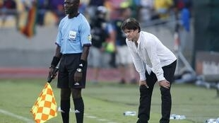 Togo's head coach Didier Six (R)