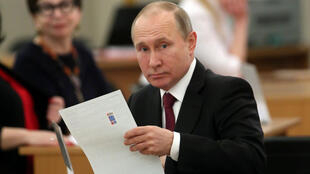 Vladimir Putin en un centro de votación, 18 marzo 2018.