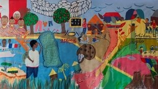 La fresque gagnante du concours «Vos talents pour les réfugiés», organisé par Amnesty International, grande de 8 mètres carrés, sera visible à partir du début du mois de septembre. Elle a été réalisée par une trentaine de réfugiés.