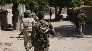 Niger government troops patrol the border between the south-east region of Diffa and Nigeria