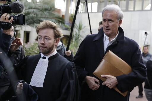 Georges Tron (R) arrives at court last month with his lawyer