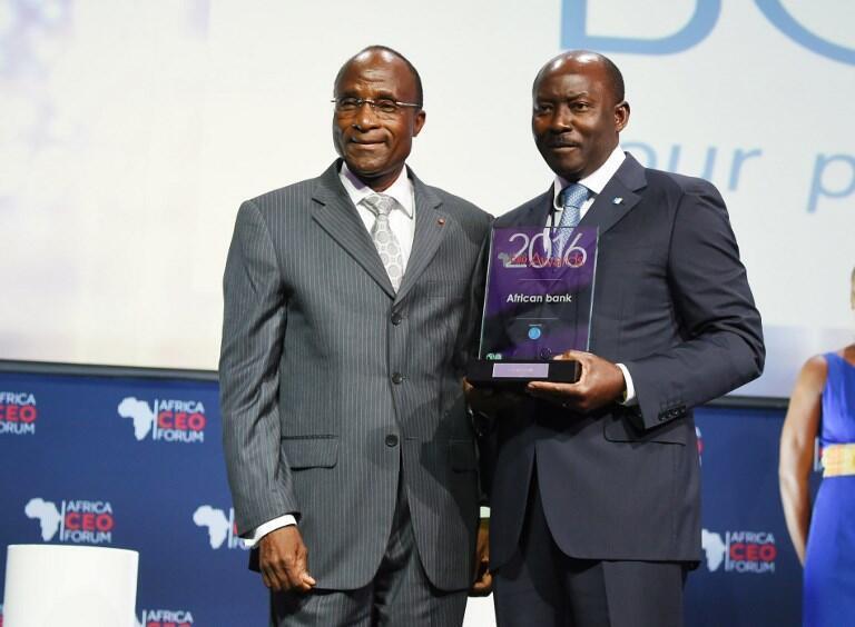 Henri-Claude Oyima à droite est le directeur général de la BGFI (ici le 21 mars 2016, à Abidjan).