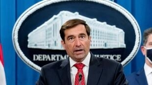 Assistant US Attorney General John Demers announces the indictment of six Russians for cybercrimes