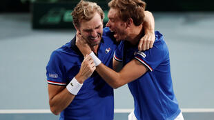 Julien Benneteau (left) and Nicolas Mahut beat the Spanish duo Feliciano Lopez and Marcel Granollers to send France into the Davis Cup final.