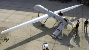 The United States has started using armed drones against Muammar Kadhafi's troops.