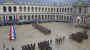 A ceremony at Paris' Invalides for seven soldiers killed in Afghanistan in July 2011.