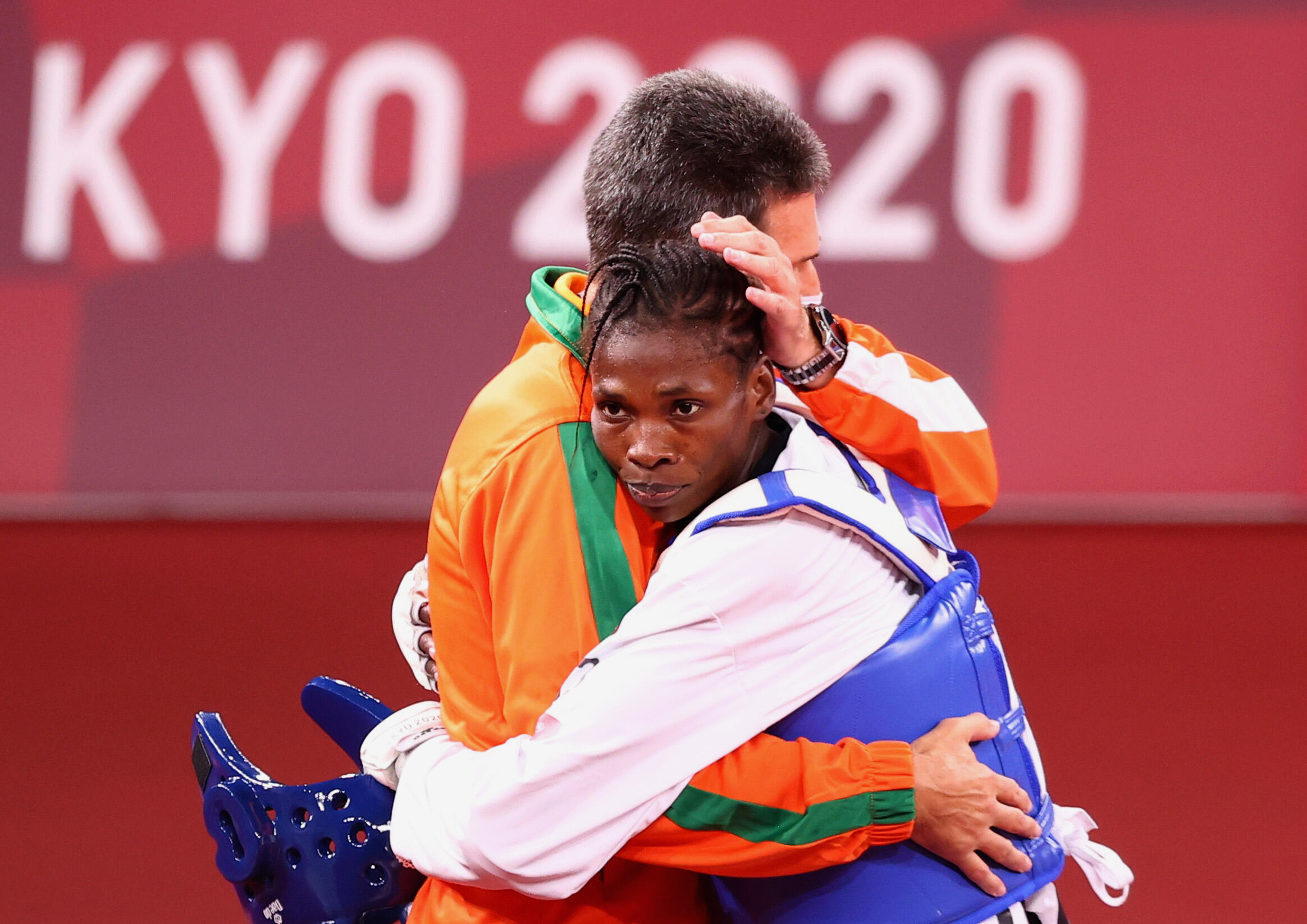 Nigerian Tekiath Ben Yessouf with her coach at the Tokyo 2021 Olympic Games.
