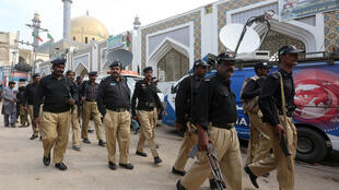 Pakistani police at the Lal Shahbaz Qalandar shrine, where the attack took place on February 16