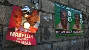 Everywhere in Port-au-Prince are plastered posters of Mirlande Manigat and Michel Martelly, as well as former president Jean-Bertrand Aristide.