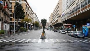 A deserted street in Catania, Sicily, after Italy reinforced the lockdown measures to combat the coronavirus disease, 21 March 2020.