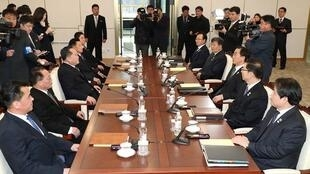 South and North Korean delegations attend their meeting at the truce village of Panmunjom in the demilitarised zone separating the two Koreas, South Korea, January 9, 2018.
