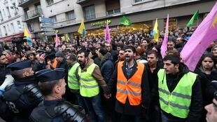 Kurds demonstrate in front of the Kurdish Information Centre in Paris's 10th arrondissement