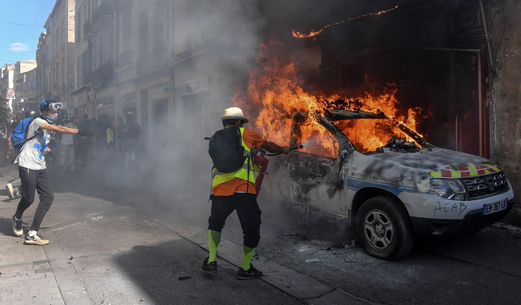 A police vehicle is set on fire in Montpellier during the resumption of Yellow Vests protest across France, 7 September 2019.