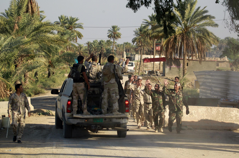 La coalition anti-jihadiste va envoyer quelque 1 500 soldats pour aider les soldats irakiens - ici photographiés en octobre 2014 - à lutter contre l'organisation Etat islamique.