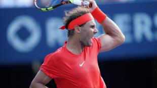 Rafael Nadal returns a ball to Stefanos Tsitsipas