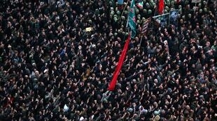 Iranians gather to mourn General Qassem Soleimani, head of the elite Quds Force, who was killed in an air strike at Baghdad airport, in Tehran, Iran January 4, 2020.