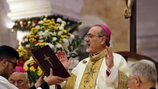 Le patriarche latin de Jérusalem Mgr Pizzabella a célébré la messe de minuit à Bethléem le 24 décembre 2019.