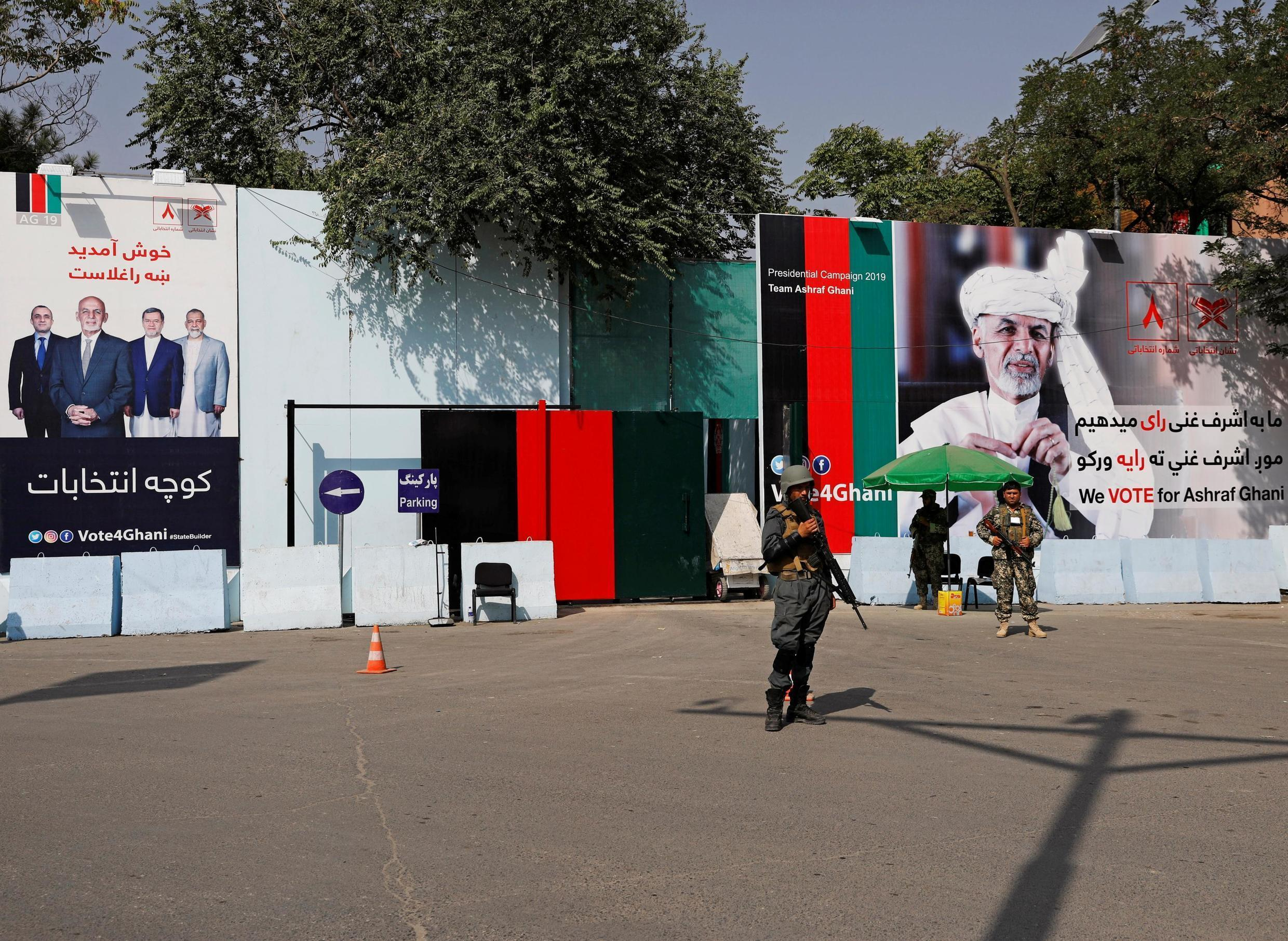 Security forces stand in front of posters of Afghan presidential candidate Ashraf Ghani in Kabul, Afghanistan, on 2 September, 2019.