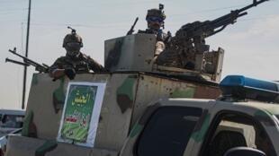 Des membres des forces de sécurité irakiennes montent la garde (image d'illustration).