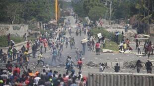 Les manifestants, à Port-au-Prince, demandent le départ de Jovenel Moïse, le 27 septembre 2019.