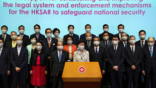 """Hong Kong Chief Executive Carrie Lam and her full cabinet gather to express """"full support"""" for Beijing's national security legislation"""