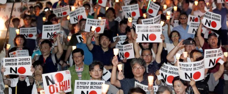 日韩恶斗战火升级美国幕后牵制韩国