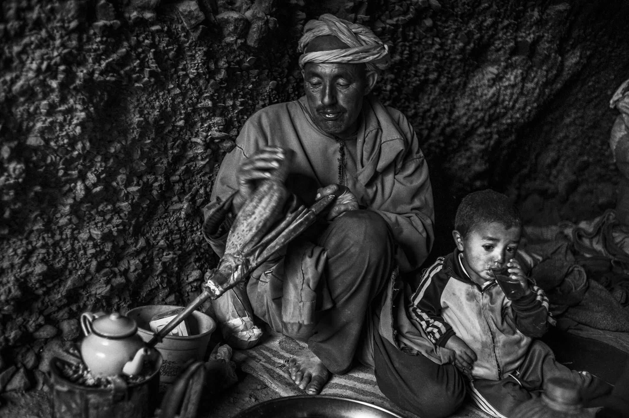 """Mohamed preparing tea before leaving his cave.  """"We are born to work, live and die."""" Tinfgam, Atlas Mountains, 2016."""