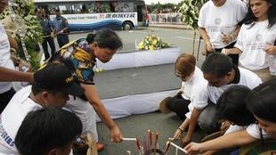 Filipinos lay flowers in memory of the victims