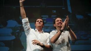Albert Rivera, líder de Ciudadanos, y Pablo Iglesias, líder de Podemos, en un debate el pasado 27 de noviembre en la Universidad Carlos III de Madrid.