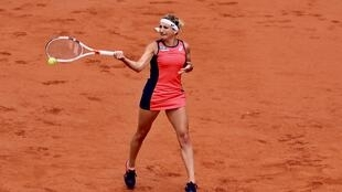 Timea Bacsinszky beat the French player Kristina Mladenovic to reach the semi-final at Roland Garros.