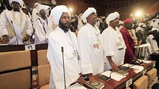 Members of parliament giving oath at the National Assembly during the first session of parliament in Omdurman - Khartoum