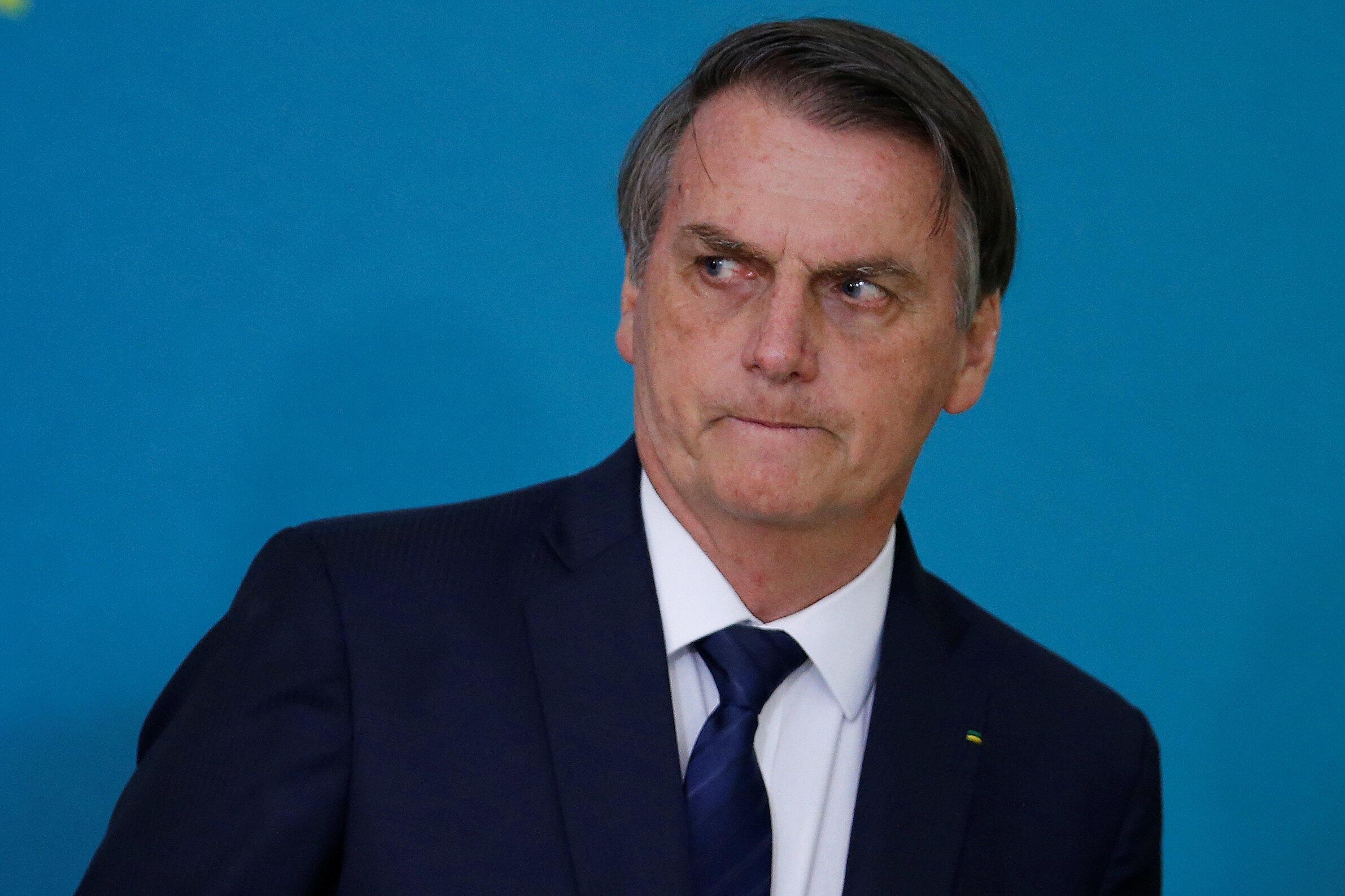 O presidente do Brasil, Jair Bolsonaro, assiste à cerimônia de apresentação da 2ª fase da campanha publicitária do projeto de reforma da Previdência no Palácio do Planalto, em Brasília, no dia 20 de maio de 2019.
