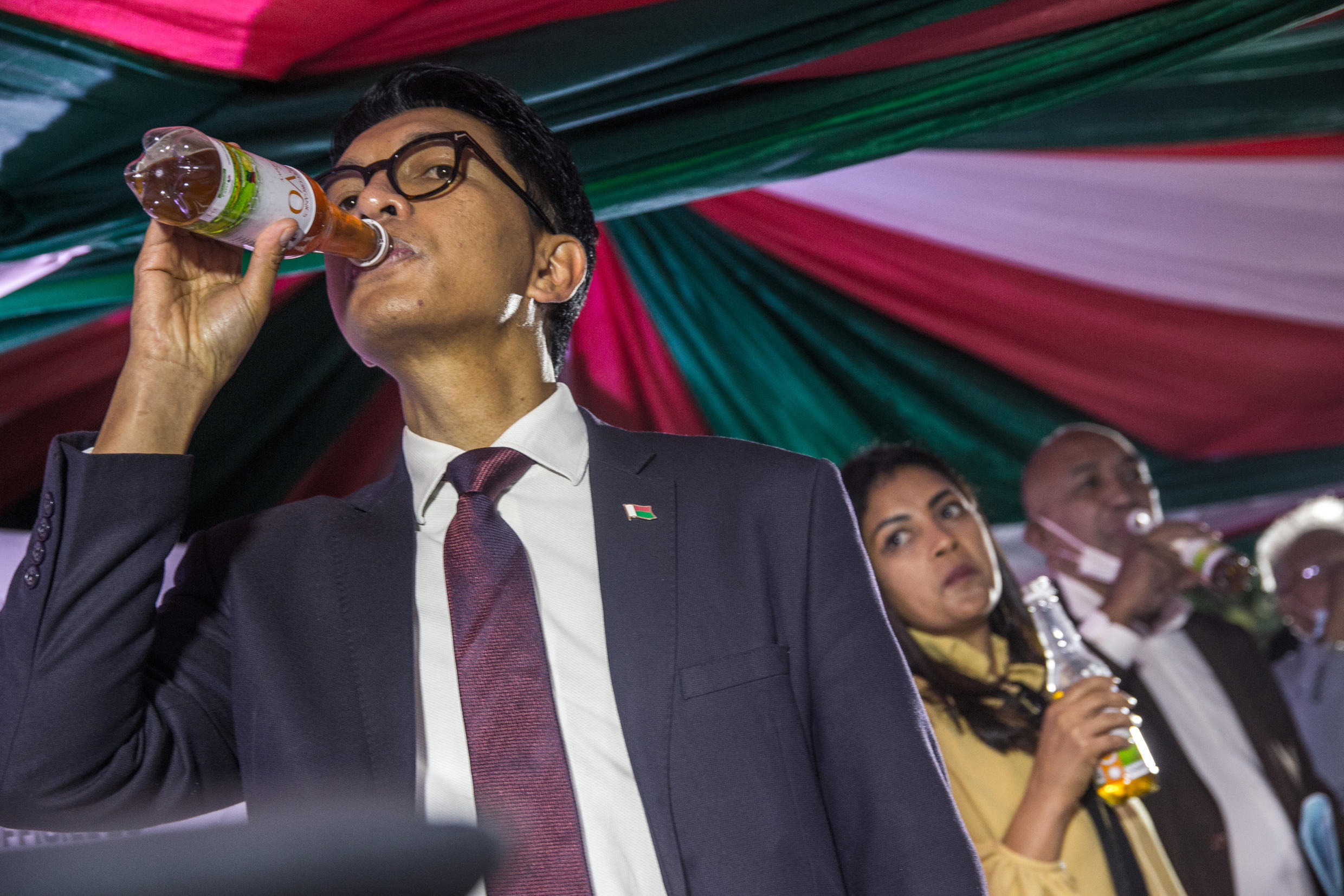 Madagascar's President Andry Rajoelina drinks Covid-Organics at a launch event in Antananarivo on 20 April 2020.