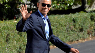 U.S. President Barack Obama waves to the press as he departs the White House in Washington, U.S., for a day trip to Orlando, Florida, to campaign on behalf of Democratic presidential nominee Hillary Clinton, November 6, 2016.