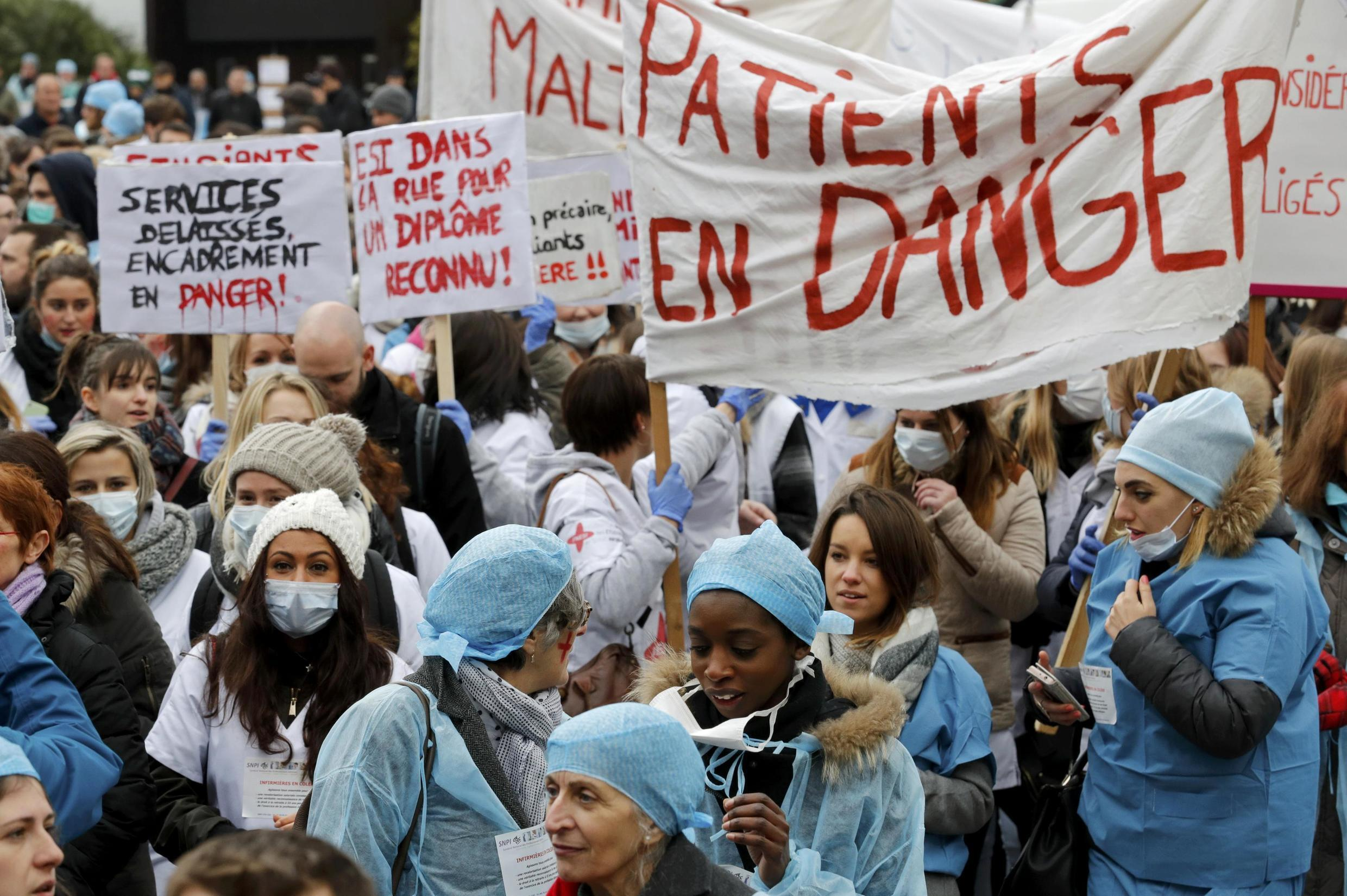 Nurses and health sector employees attend a demonstration to protest their working conditions in Paris in 2016
