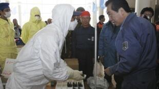 PM Naoto Kan visits J-village in disaster zone