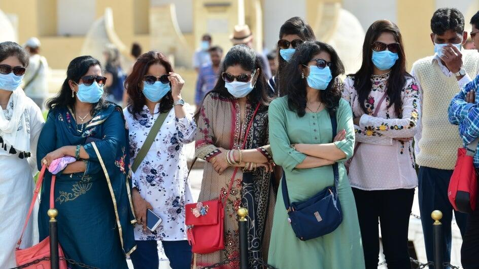 Members of the public in India wear masks to protect against coronavirus