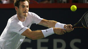 Andy Murray hits a shot against Kei Nishikori during the Rogers Cup tennis tournament, 15 August 2015