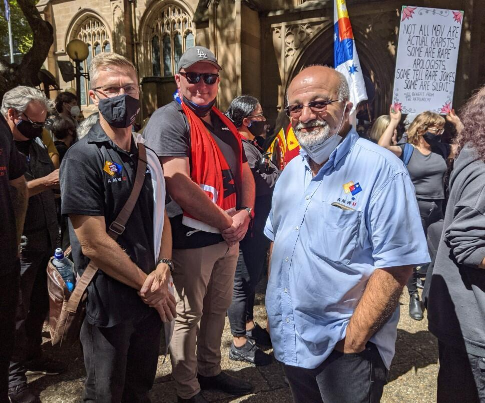 """""""It's important that men support the women here in the community, whether or not they're partnered with a woman, it's really important from a community sense to make sure the rights of all people, including women, prevail equally,"""" says George (in blue) at the March 4 Justice rally in Sydney, 15 March 2021."""