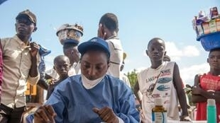World Health Organization nurses prepare to administer vaccines at the city of Mbandaka on May 21, 2018 during the launch of an Ebola vaccination campaign as the death toll in DR Congo continues to rise