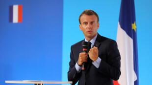 O Presidente francês, Emmanuel Macron, usando da palavra na apresentação do plano para os subúrbios. Paris, 22 de Maio de 2018.