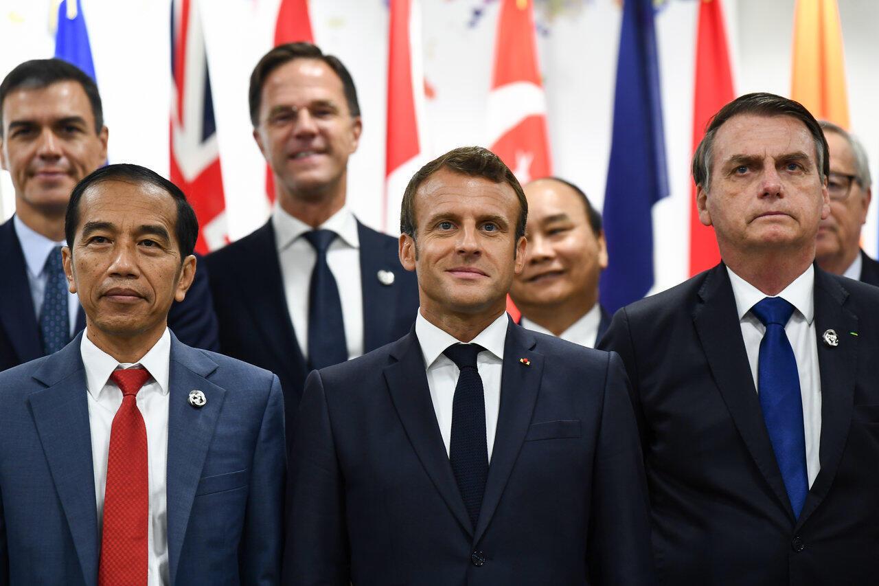 Tổng thống Pháp Emmanuel Macron và đồng nhiệm Brazil Jair Bolsonaro ngày 29/06/2019 tại hội nghị G20 ở Osaka (Nhật).