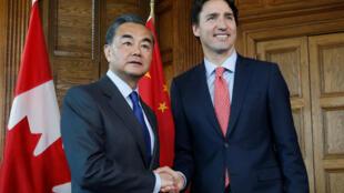 資料圖片:加拿大總理杜魯多2016年6月1日與到訪的中國文章王毅會晤。