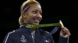 French boxer Estelle Mossely poses with her gold medal after winning the 60 kg final on Friday.
