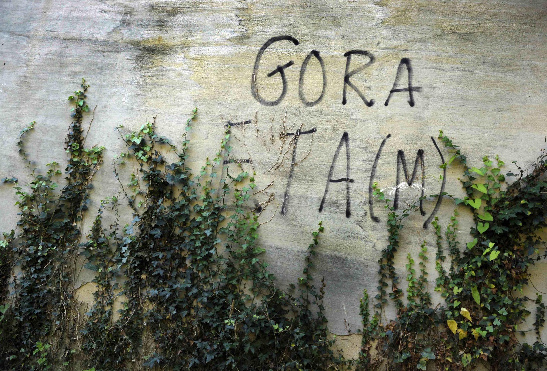 Eta slogan on a farmhouse wall near a Basque village
