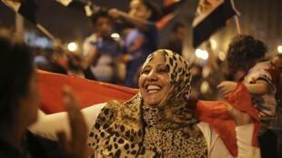 Partidários de Abdel Fattah al-Sisi comemoram sua eleição na Praça Tahir, no Cairo, nesta quinta-feira, 29 de maio de 2014.