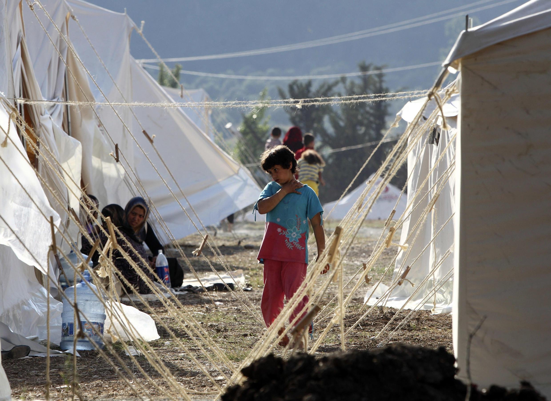Refugiados sírios na cidade turca de Yayladagi, na fronteira entre os dois países.
