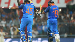 Rohit Sharma and Virat Kohli celebrate after scoring hundreds against the West Indies.