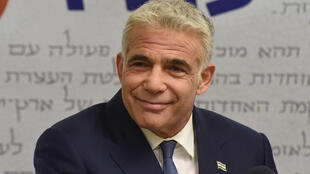 Israel's centrist opposition leader Yair Lapid announced the deal to unseat veteran Prime Minister Benjamin Netanyahu less than an hour before a midnight deadline
