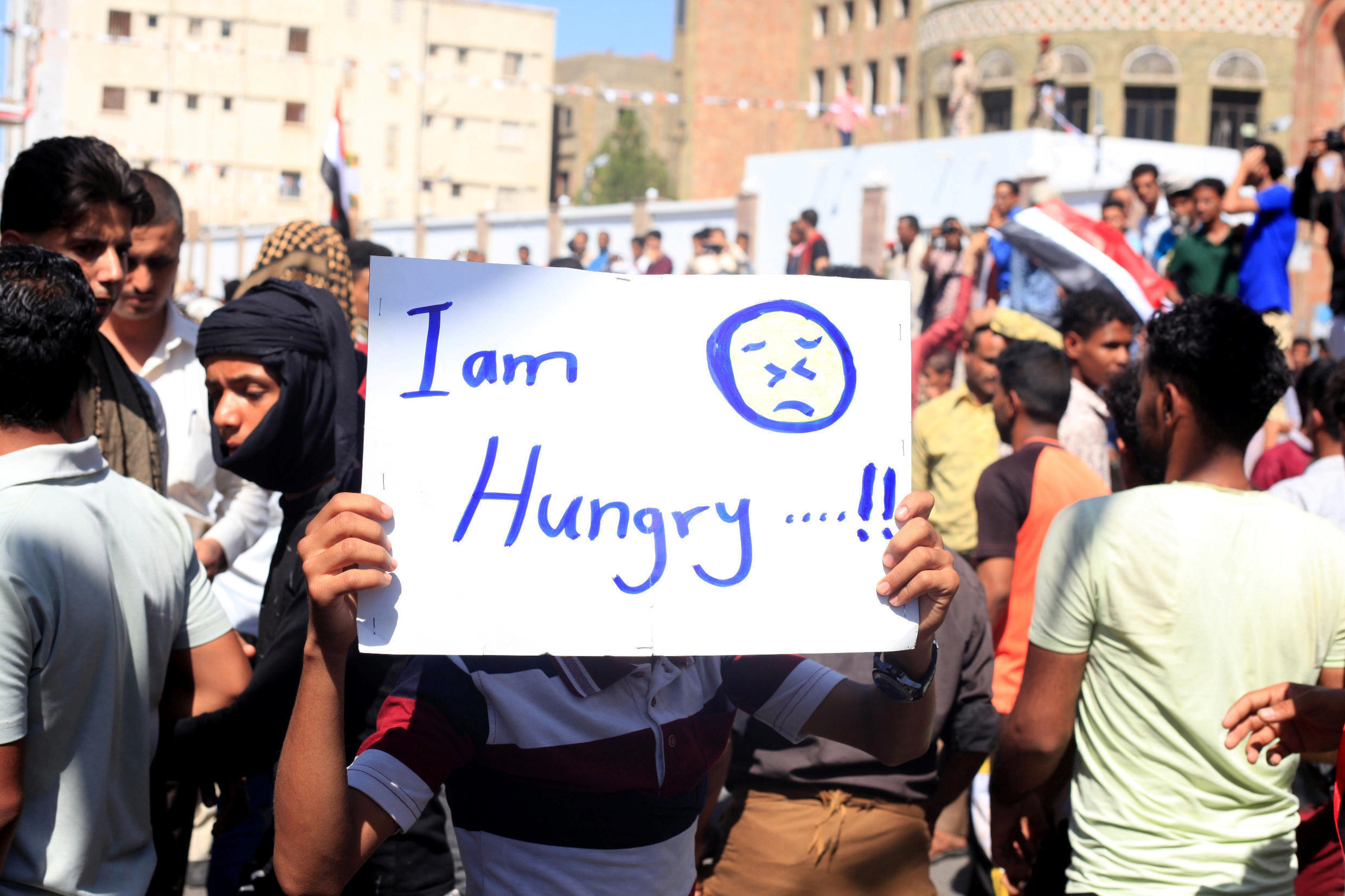 The Yemeni riyal has fallen nearly 40 per cent this year, causing a steep rise in prices. Civilians protest in Taiz, 4 October 2018.
